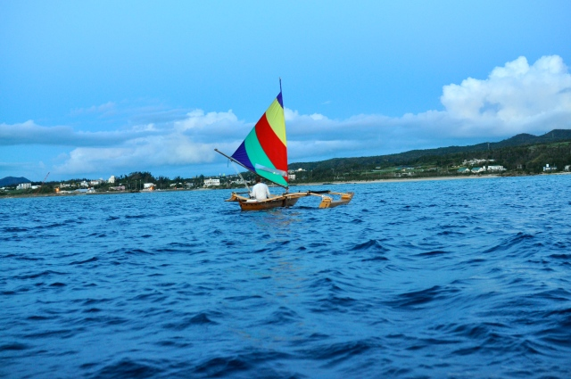 A guy in an outrigger sped by