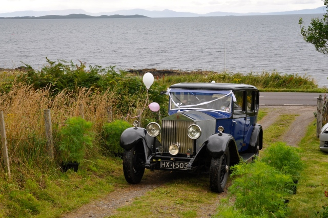 The bride arrives. Vintages Rolls are the normal form of transport. The glass screen between the back seats and the driver stops the sheep licking your neck