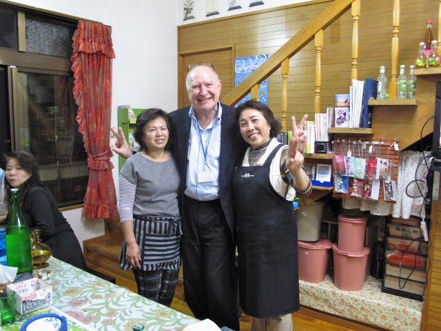 Miyazato san and Noda san in their front room that doubles as a restaurant. The big plastic pails are full of pickles.
