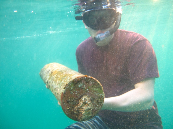 Ben finds old naval shell case like on the bottom of the sea. I have swum over this bit many times and never saw it. Ben is good at this kind of thing.