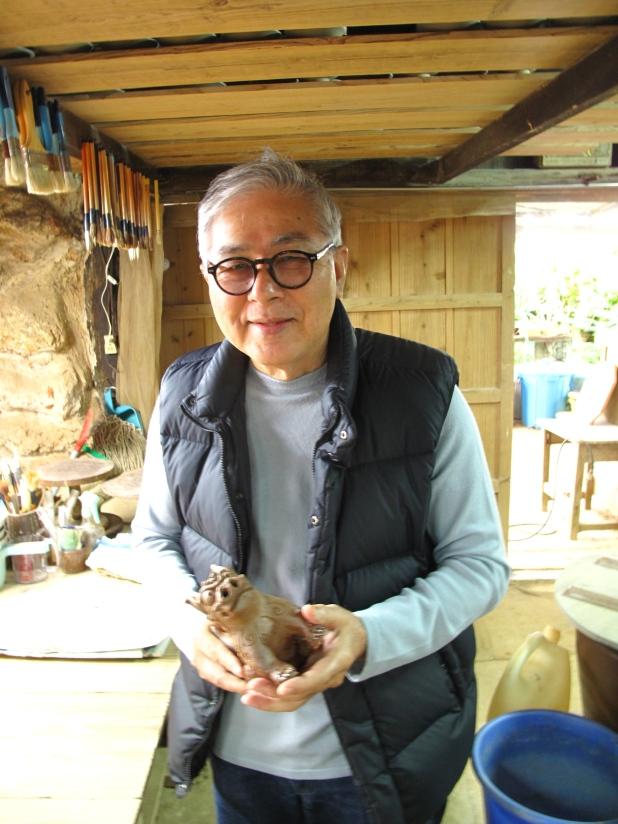 Yamada sensei, the world's greatest ceramicist, well around here, with Ben's shisa.