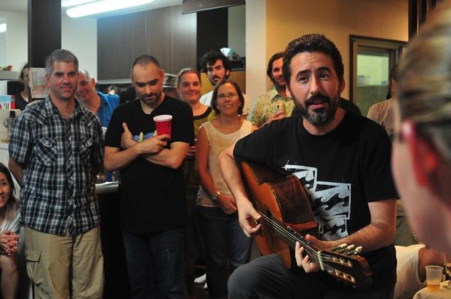 Juan Luis, the quantum cowboy, sings.